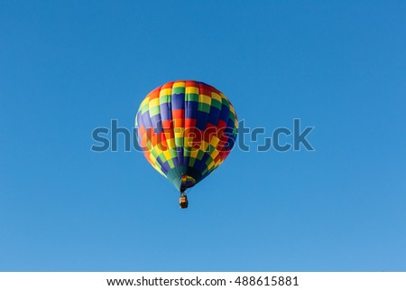 Hot air balloons in the air at a festival