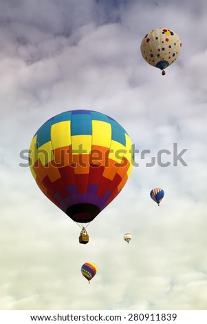 Hot air balloons in the sky off for a magical journey - stock photo