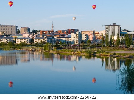 Hot air balloons over Helsinki. - stock photo