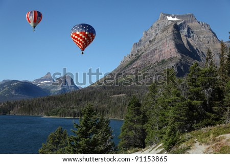 Hot Air Balloons Over Montana Mountainous Terrain - stock photo