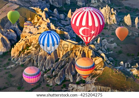 Hot air balloons over mountain landscape in Cappadocia, Goreme National Park, Turkey. Aerial view from air balloon