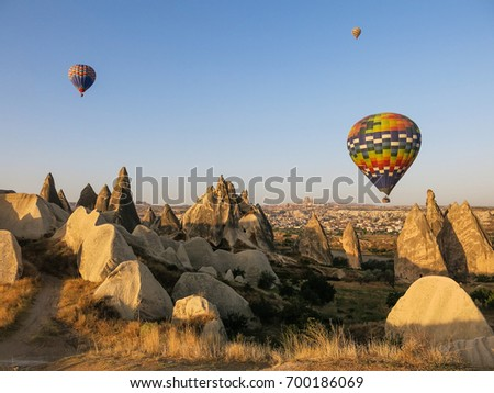 Hot air balloons over rock formations in Cappadocia, Turkey