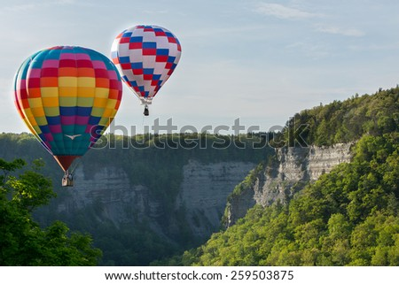 Hot air balloons over the gorge at Letchworth State Park. - stock photo