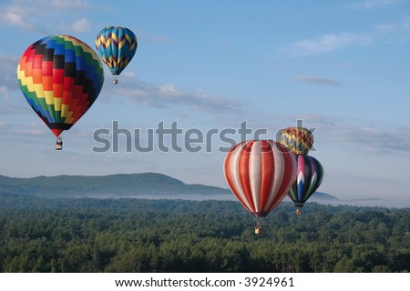 Hot Air Balloons Soaring in the Summer Sky - stock photo