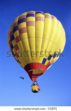 Hot air Baloon in a clear blue sky - stock photo