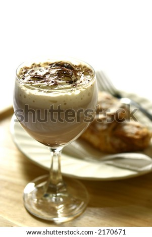 Hot almond croissant on white place against white, on wooden mat with copyspace. - stock photo