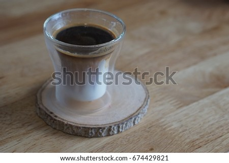 Hot americano A cup Coffee on wood coaster