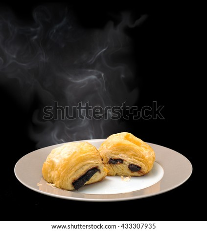 Hot and cold chocolate croissant on ceramic plate