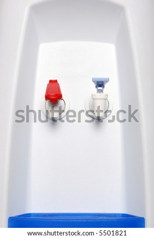 hot and cold faucet of water dispenser - stock photo