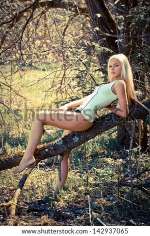 Hot and sexy blond woman outdoor - stock photo
