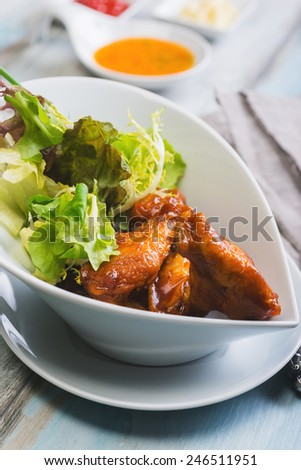 Hot and spicey chicken wings with celery - stock photo