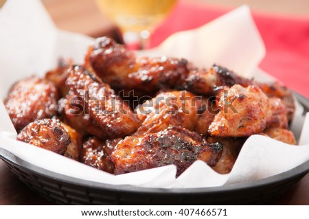 hot and spicy buffalo style chicken wings in a basket - stock photo