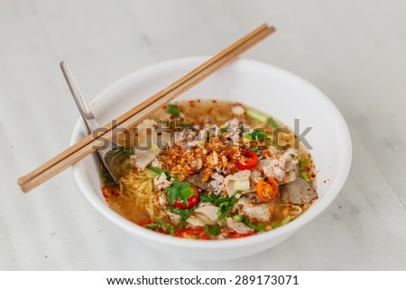 hot and spicy noodle soup with pork in Thai style - stock photo