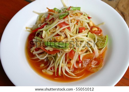 Hot and spicy papaya salad - stock photo