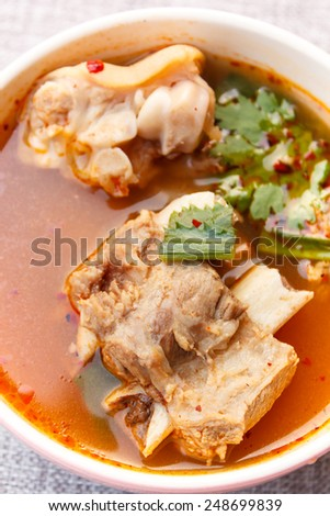hot and spicy soup with pork ribs. - stock photo