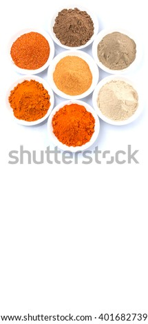 Hot and spicy spices powder, cayenne powder, chilly powder, peppercorn powder, paprika powder, black pepper and white pepper powder in white bowl over white background