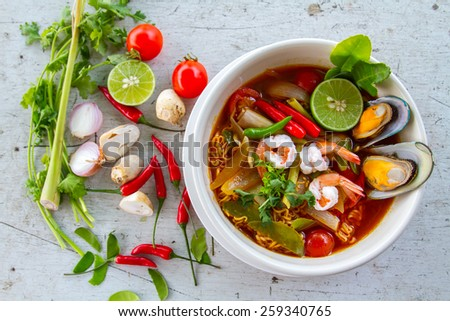 hot and spicy Thai soup with seafood - stock photo