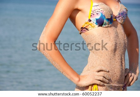 Hot and wet. Close-up of sandy woman perfect body - stock photo