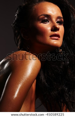 Hot and wet girl on dark background
