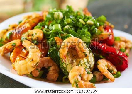 hot appetizer with vegetables and prawns