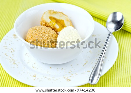 hot apricot dumpling with cold ice cream - stock photo