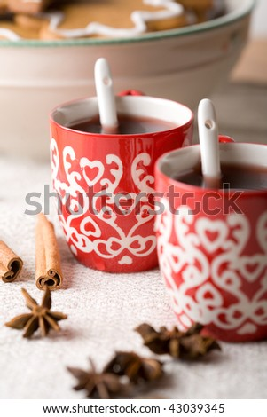 Hot aromatic Christmas drink, mulled red wine, Christmas glogg, with cinnamon sticks and star-aniseed - stock photo