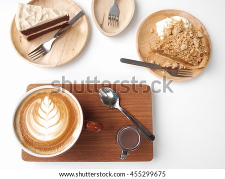 Hot art Latte Coffee in a cup on wooden plate and cakes on wooden plate white table, coffee break set   - stock photo