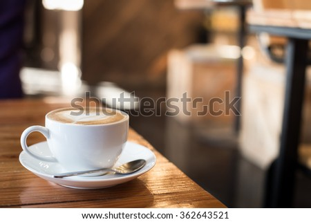 Hot art Latte Coffee in a cup on wooden table - stock photo