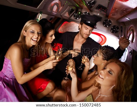 Hot bachelorette party party in limousine with handsome chauffeur and beautiful girls.