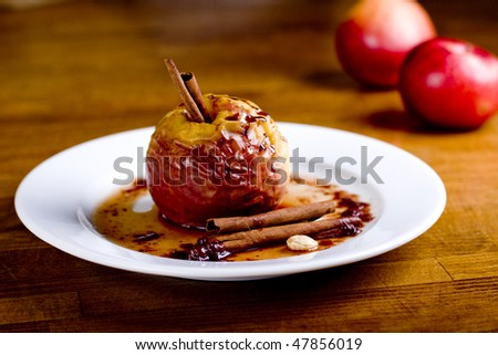 Hot baked apple with cinnamon sticks