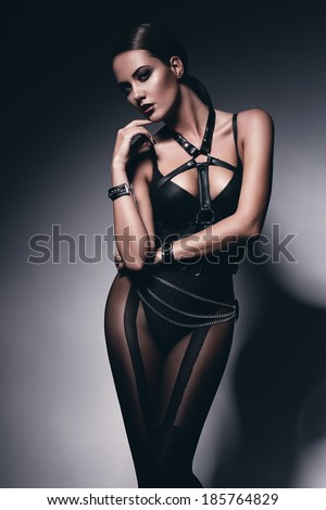 hot bdsm woman in corset - stock photo