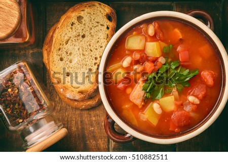 Hot bean soup with bacon and vegetables.