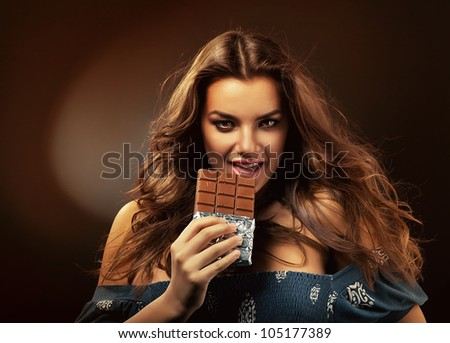 hot beautiful woman with chocolate - stock photo