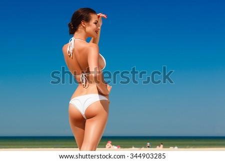 hot beautiful young woman in white bikini enjoying on the beach sea - stock photo