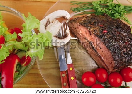 hot beef on transparent plate with salad bowl - stock photo