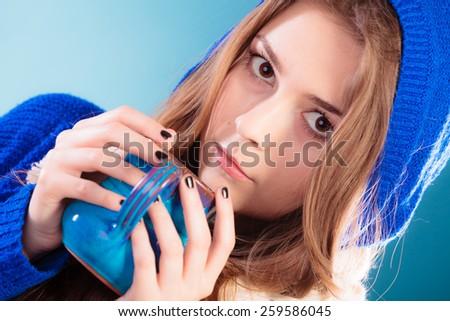 Hot beverage. Closeup teen girl holding blue mug with drink tea or coffee. Woman warming herself - stock photo