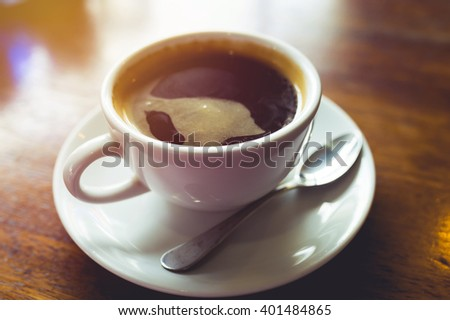 Hot black coffee on table. Vintage filter - stock photo
