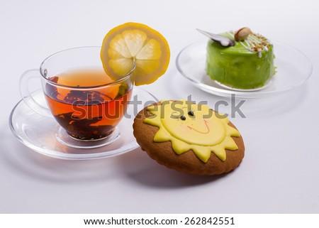 Hot black tea with delicious unusual desserts  - stock photo