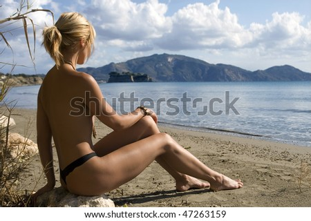 Hot blond girl on the beach - stock photo