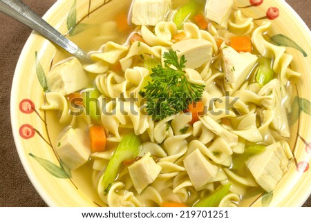"""hot bowl of chicken noodle soup ready to enjoy """"chicken noodle soup"""", - stock photo"""
