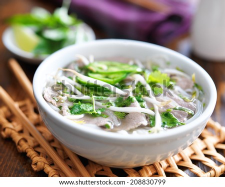 hot bowl of pho with beef and rice noodles - stock photo