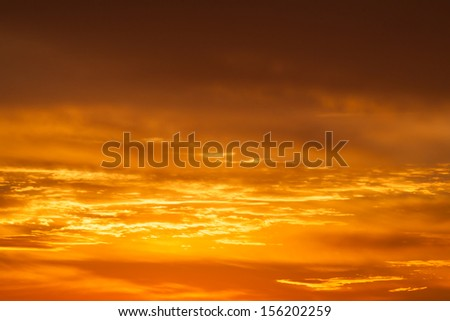 Hot bright vibrant orange and yellow colors sunset sky - stock photo