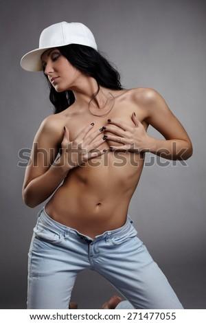 Hot brunette posing nude to waist. Studio shot - stock photo