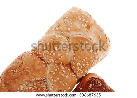 hot bun of light wheat bread topped by sesame seeds isolated over white background - stock photo