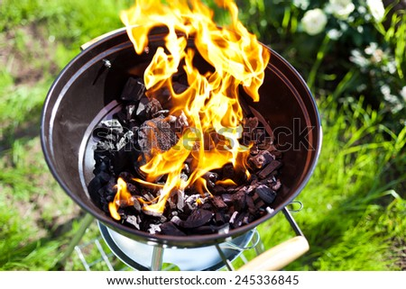 Hot burning charcoal, grill on fire - stock photo