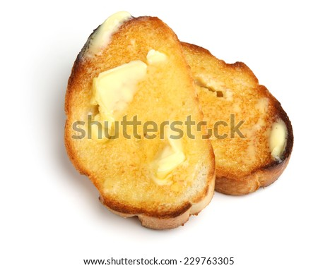 Hot buttered toast slices on white background