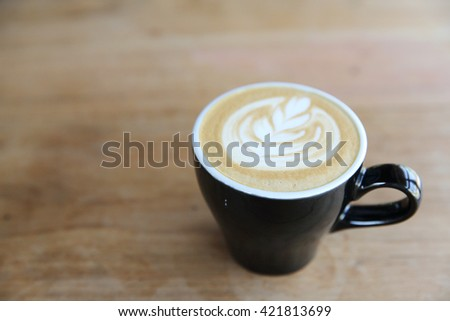 hot cappuccino coffee on wood background - stock photo