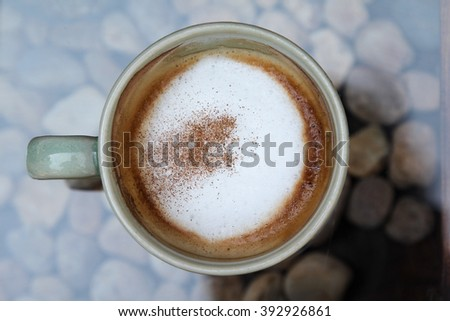 Hot cappuccino in white cup on table. - stock photo