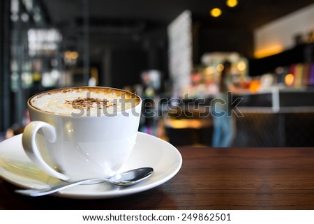 Hot cappuccino on the table with coffee shop background  - stock photo