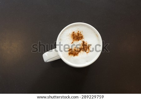 Hot cappuccino with cinnamon on top - stock photo